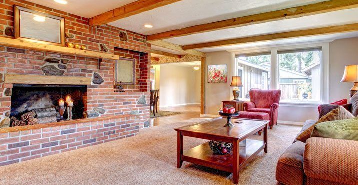 Living room interior with brick fireplace, wood beams and red. - Speedy White Cleaning Products For Fireplace, Hearth And Home